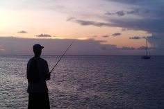 A local fishing at the pier