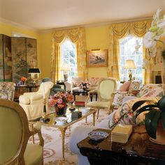 Gorgeous warm yellow room filled with color & timeless style by Mario Buatta