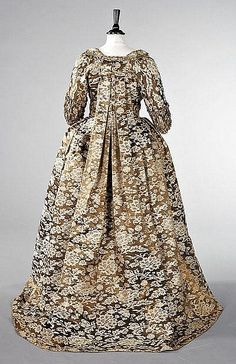 Back view, robe à la Francaise, c. 1760, the fabric c. 1750. Chinese lampas silk satin woven with bronze and cream peonies and coiling foliage, the open-robe and petticoat trimmed with furbelows of matching braid trimmed silk, the sleeves with shirred double ruffled `sabot' cuffs.