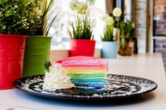 Rainbow crepe cake, with 20 layers and seams of whipped cream, at Dek Sen in Elmhurst, Queens. Credit Stephen Speranza for The New York Times