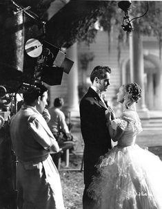 Director William Wyler keeps an eye on the stars of Jezebel, Henry Fonda and Bette Davis 1938
