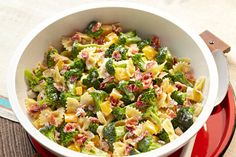 Broccoli florets, crumbled bacon, chopped peppers and bow-tie pasta make this cold summer salad as colorful as it is tangy.