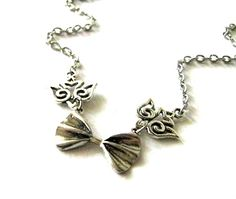 Antiqued silver bow necklace jewelry with bird charm connectors