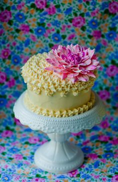 Design for a tiered birthday cake decorated with exotic flowers see
