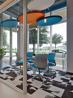 FLOR / Mod Cow-Black / Austin Realty / Austin, TX / A fun and modern office space with our Mod Cow style and bright blue chairs.