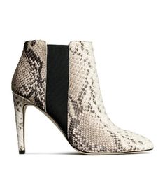 PREMIUM QUALITY. Ankle boots in snakeskin-patterned leather with elastic panels at sides. Leather lining, leather insoles, and rubber soles. Heel height 4 in.