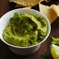 The food processor makes quick work of this basic dip that's rich in heart-healthy monounsaturated fats. We like the heat from leaving the seeds in the jalapeño, but you can seed the pepper for a milder guac. Serve with tortilla chips or crudités.
