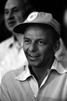 """francisalbertsinatra:  """"Frank Sinatra watching the boxing match between Floyd Patterson and Ingemar Johansson in Miami Beach, Florida on March 13, 1961. Photographed by Stanley Weston  """""""