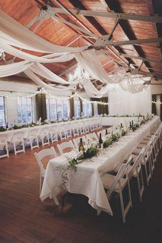 white-garland-centerpiece-tables-reception-decor