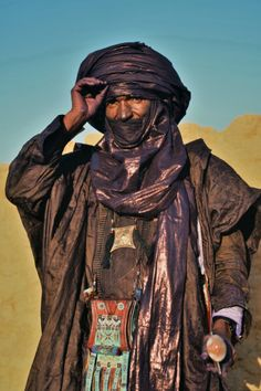 Africa | Tuareg man wearing a traditional 'Amenokal'. Algeria | Photographer Friedrich Schmidt