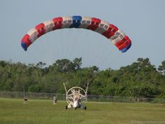 A powered parachute gets ready to take off