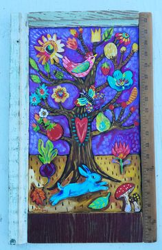 Original folk art painting in a rustic handmade frame. I used layers of acrylic paint to create the rich vibrate color. The frame is made from scrape wood and a vintage yardstick. It measures 12.5 …