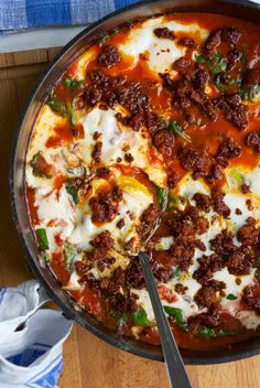 Eggs in tomato sauce with crispy chorizo and spinach