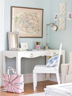 If you need a desk or work space in the living room, go for the prettiest office accessories you can find, and use a dining chair as a stylish, streamlined seat.