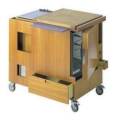 joe columbo 1963 mini kitchen. it has a fridge, stove, storage and chopping board built into one
