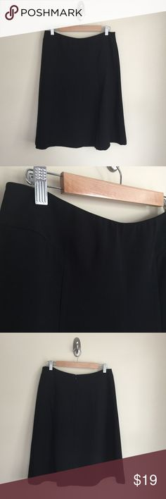 """NY&Co black midi length A-line skirt sz 8 New York & Company black skirt, size 8. A-line, midi length, tailored styling with seam detailing, rear zip closure, unlined. Condition:  excellent pre-loved. Material:  100% polyester. Measurements (approximate, taken laying flat):  length 25"""", flat waistband 15.5"""", flat hip 20"""". New York & Company Skirts Midi"""