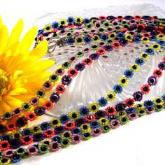 Retro Flower Power Bead Woven Long Seed Bead Necklace. $65.00, via Etsy.