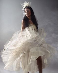 Z MALAN birdcage veil with hand beaded feather fascinator for wedding, bridal, and special occasions    www.zmalan.com