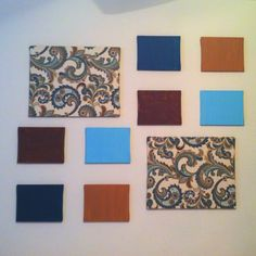 Wall art: fabric stretched over two large canvases, and eight painted smaller canvases.