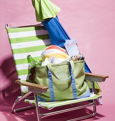 A beach chair with a bag and umbrella.