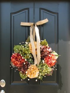 Fall wreath.  I'd use a burlap bow instead.