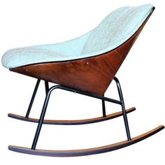 Rocking chair by Plycraft    1950's  A rare rocking chair with bent plywood back and metal frame by Plycraft. New upholstery and refinished.