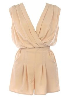 Wrapped Vanilla Romper: Features a luxe wrap-over bodice with relaxed tailoring to produce a chic silhouette, dimension lending pleats throughout, rear smocking for a custom fit, and adorable romper shorts with pockets to finish.