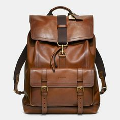 I hate that this is Coach because that means I'll never be able to afford it. Curse my love for brown leather bags!