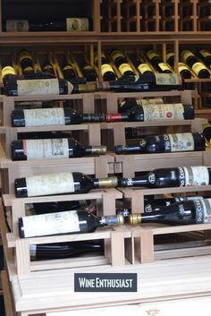 A double waterfall wine rack display in the center of a custom wine cellar showcases some of this customer& most prized collections. Wine Cellar Racks, Wine Rack, Cooling Unit, Wine Cellar Design, Wine Collection, Flat Shapes, Craft Stick Crafts, Diy Crafts, Wine Storage
