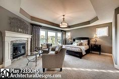 Master Bedroom of Craftsman with great room.  [This room...the gray, tray ceiling, fireplace, and master bath, are soooo great!]