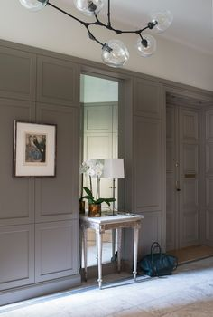 Entry by Birgitta Örne Interior Design Wallpaint and stonefloor by Fired Earth