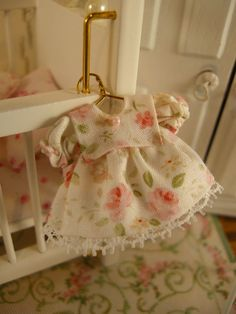 miniature dollhouse baby dress. $12.50, via Etsy.