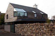 extended konishi gaffney residence exterior rock wall