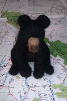 """Hudson"" the Black Bear; 2014; needle felted sculpture by Holly Boone of Polar Lights Art Studio. Currently located at the Alberta Craft Council. - SOLD! http://polarlightsart.wix.com/plas#!hollys-work/cq0w"