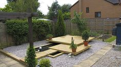 Backyard With Floating Deck And Gravels