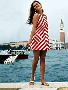 Claudia Cardinale in Venice - Florida girl's late 60's uniform: a-line minidress, thong sandals, big earrings, big sunglasses and a dark tan