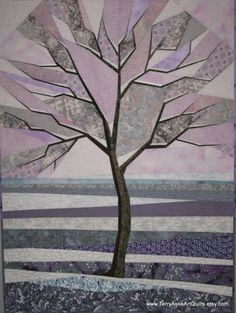 Frosty Winter Morning – A solitary tree with snow laden branches is silhouetted against a wintery morning sky. The colors of this quilt were inspired by the two fabrics at the bottom of the quilt featuring plants covered with frost. Many other pale and pastel shades of pink, lavender and gray evoke a cold and frosty feeling. To design the tree, I grafted together photos of several trees in my neighborhood – the trunk from one or two trees, branches from several others. The branches were…