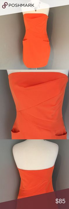 "SUMMER SALE ABS Allan Shwartz Collection Strapless Lovely orange strapless - wear it throughout the year  - built in corset bra with draping at center to flatter any figure - will fit 34-36"" bust - waist is 32"" and length is 26"" - 95% polyester and 5% spandex ABS Allen Schwartz Dresses Strapless"