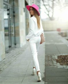all white outfit and pink hat