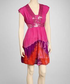 A frock that's fun and elegant too? Sign us up! Glittering sequins dazzle the top, while color-soaked tie-dye pops below.