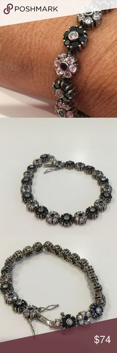 🍎 925 SS floral tennis bracelet 925 SS floral tennis bracelet. Sterling silver with clear and black stones create a beautiful floral tennis bracelet. I'm not sure what the stones are. Jewelry Bracelets