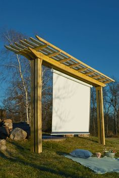 Outdoor Theatre woodworking plan. By day, an easy-swinging hammock holder. By night, a neighborhood theatre screen.