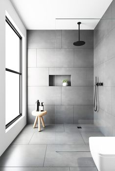 bathroom tiles Would you dare to go dark We love a dramatic space and this bathroom was created with our Evolution Matt Natural Grey tiles. Made from hard wearing porcelain they feature an authentic brushed stone effect finish . Grey Bathroom Tiles, Bathroom Tile Designs, Bathroom Design Luxury, Bathroom Flooring, Shower Tiles, Large Tile Shower, Master Bathroom, Grey Tile Shower, Bathroom Feature Wall Tile