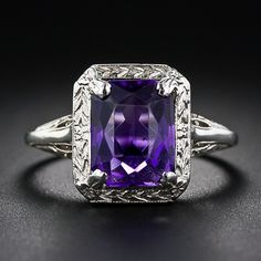 Vintage Amethyst Ring. I would love a wedding band like this. Silver with a purple stone