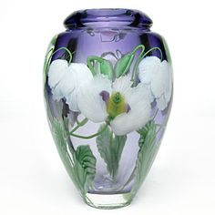 """Six white poppies enfold this transparent lavender vase. The decoration is drawn with hot glass at the torch and encased in seamless layers of clear glass."" ~ Daniel Salazar"