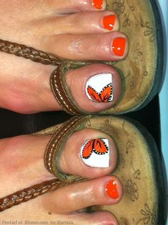 Cute toe nail designs of an orange butterfly