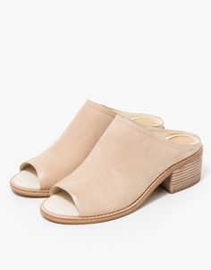 From Dolce Vita, a classic mule in Ivory. Features a Nubuck upper, pointed toe, padded footbed for comfort, synthetic sole and a stacked heel.   • Classic mule in Ivory • Nubuck upper • Pointed toe • Padded footbed • Synthetic sole • Stacked heel