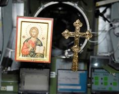 The cross circles the earth 16 times a day. The Gospels, four icons, crosses and a relic of the True Cross are aboard the Russian segment of the International Space Station (ISS). A photo taken by the station crew shows an icon and a crucifix floating in zero gravity in the ISS.
