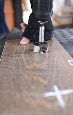 Creating hole in flooring with forstner bit to create space for bolts   MountainModernLife.com Vinyl Plank Flooring, Diy Flooring, Cool Camping Gadgets, Camping Ideas, Camper Flooring, Rv Redo, Rv Interior, Camper Makeover, Mountain Modern