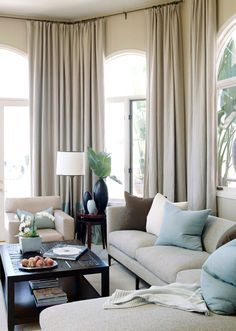 Considering corner-wrapping curtains for the living room that are mounted high on the wall to add height to the room.  http://theassistant.wordpress.com/2009/06/05/ask-amy-window-treatments-for-sliding-glass-doors/